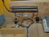 Inside cabinet tilt mechanisms